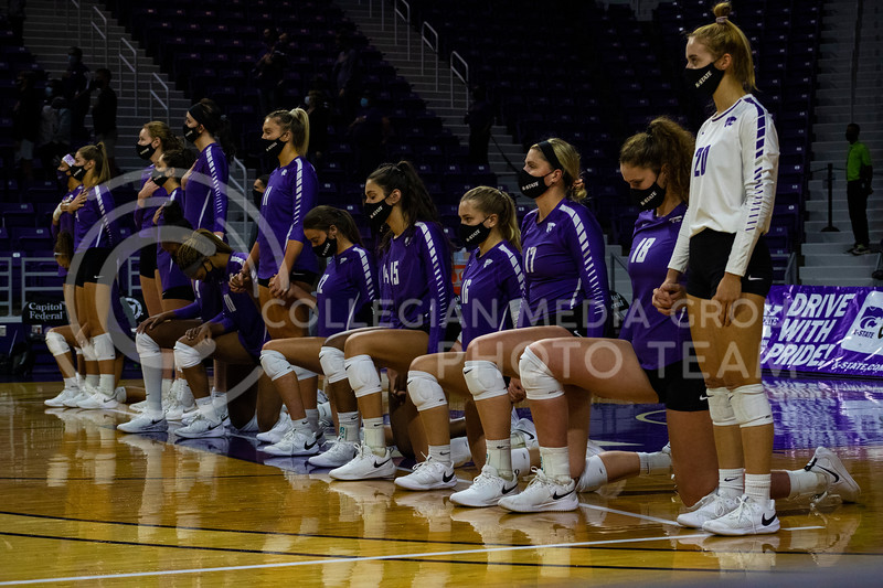 K-State volleyball players kneel during the national anthem in support of protests against racial injustice before the game at Bramledge Coliseum on October 17th 2020. The wildcats lost to the #1 ranked Texas by a score of 3-0 in the second game of the series. (Dalton Wainscott I Collegian Media Group).