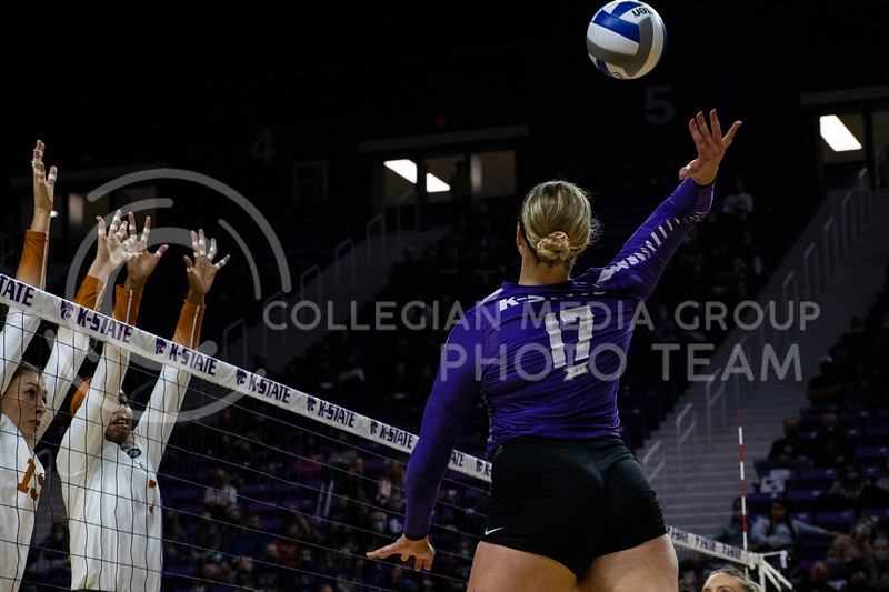 Redshirt junior defensive specialist Brynn Carlson hits the ball over the net while Texas players attempt to block the spike at the game at Bramledge Coliseum on October 17th 2020. The wildcats lost to the #1 ranked Texas by a score of 3-0 in the second game of the series. (Dalton Wainscott I Collegian Media Group).