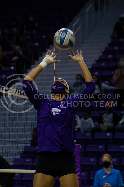 Sophomore setter Teana Adams-Kaonohi sets the ball during practice before the game at Bramledge Coliseum on October 17th 2020. The wildcats lost to the #1 ranked Texas by a score of 3-0 in the second game of the series. (Dalton Wainscott I Collegian Media Group).
