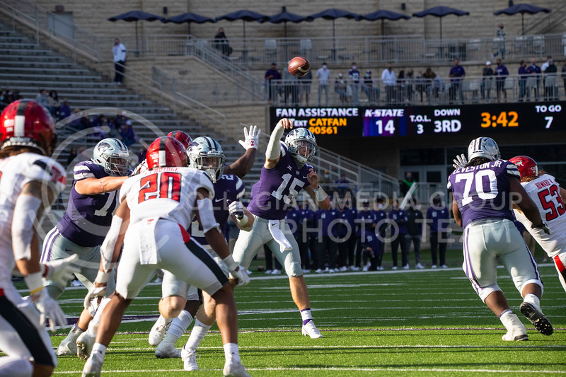 Freshmen quarterback Will Howard throws a pass to a receiver. Freshmen Running Back Deuce Vaughn outruns Texas Tech defender for touch down in first half. The Wildcats beat the Red Raiders 31-21 on Fort Riley day at Bill Snyder Family Stadium. (Dalton Wainscott | Collegian Media Group).