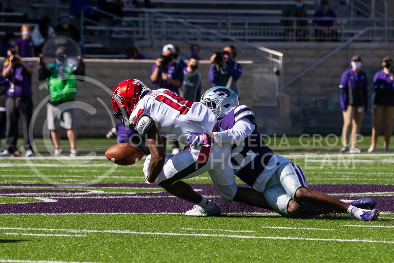 Senior defensive back Aj Parker forces a Texas Tech receiver to fumble. The Wildcats beat the Red Raiders 31-21 on Fort Riley Day at Bill Snyder Family Stadium. (Dalton Wainscott | Collegian Media Group).