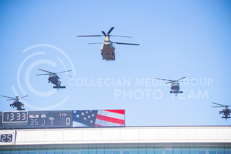 1st infantry helicopter fly over in a V formation during national anthem. The Wildcats beat the Red Raiders 31-21 at Fort Riley day at Bill Snyder Family Stadium. (Dalton Wainscott | Collegian Media Group).