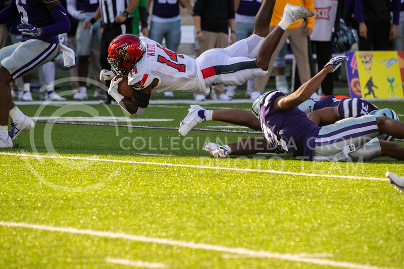 A Texas Tech receiver is launched into the air while he is tackled. Freshmen Running Back Deuce Vaughn outruns Texas Tech defender for touch down in first half. The Wildcats beat the Red Raiders 31-21 on Fort Riley day at Bill Snyder Family Stadium. (Dalton Wainscott | Collegian Media Group).