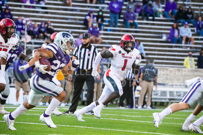 Freshmen running back Deuce Vaughn runs past Texas Tech defenders. Freshmen Running Back Deuce Vaughn outruns Texas Tech defender for touch down in first half. The Wildcats beat the Red Raiders 31-21 on Fort Riley day at Bill Snyder Family Stadium. (Dalton Wainscott | Collegian Media Group).