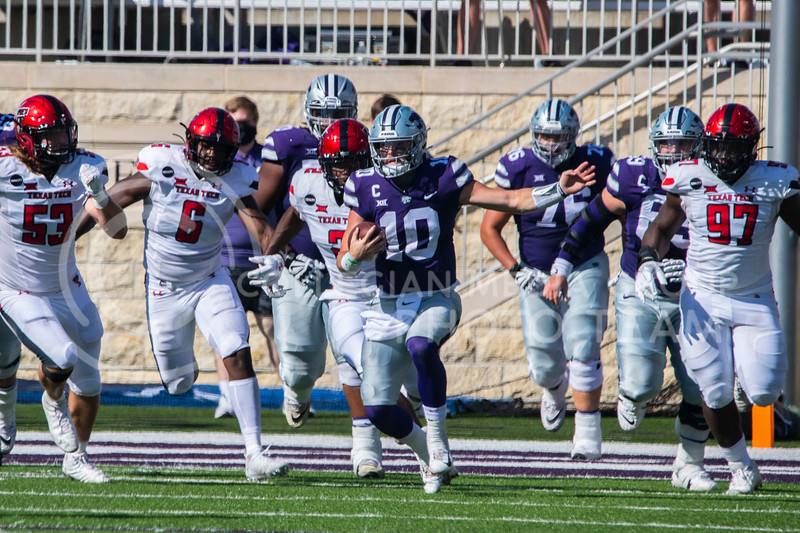 Senior quarterback Skylar Thomson runs through gap between Texas Tech defenders. The Wildcats beat the Raiders 31-21 on Fort Riley Day at Bill Snyder Family Stadium. (Dalton Wainscott | Collegian Media Group).