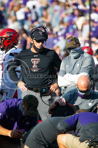 Head coach Chris Klieman talks with Matt Wells, the head coach of Texas Tech after K-State player gets injured. Freshmen Running Back Deuce Vaughn outruns Texas Tech defender for touch down in first half. The Wildcats beat the Red Raiders 31-21 on Fort Riley day at Bill Snyder Family Stadium. (Dalton Wainscott | Collegian Media Group).