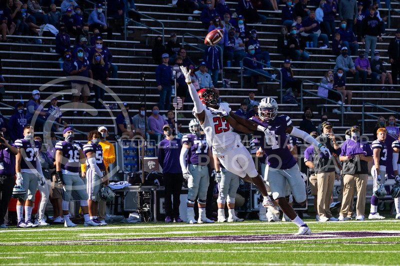 Sophomore defensive back Wayne Jones attempts to block a Texas Tech receiver from catching the ball. The Wildcats beat the Raiders 31-21 on Fort Riley Day at Bill Snyder Family Stadium. (Dalton Wainscott | Collegian Media Group).