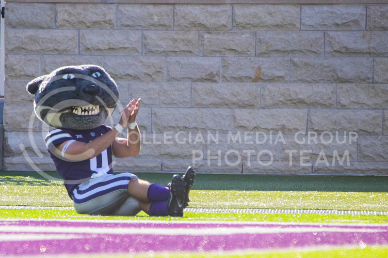 Willie the Wildcat claps as he sits on sidelines of the field. Freshmen Running Back Deuce Vaughn outruns Texas Tech defender for touch down in first half. The Wildcats beat the Red Raiders 31-21 on Fort Riley day at Bill Snyder Family Stadium. (Dalton Wainscott | Collegian Media Group).