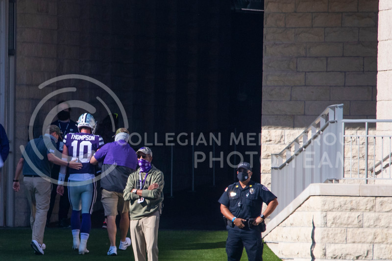 Senior quarterback Skylar Thompson walks up tunnel with the team trainer after getting injured in previous play. The Wildcats beat the Raiders 31-21 on Fort Riley Day at Bill Snyder Family Stadium. (Dalton Wainscott | Collegian Media Group).