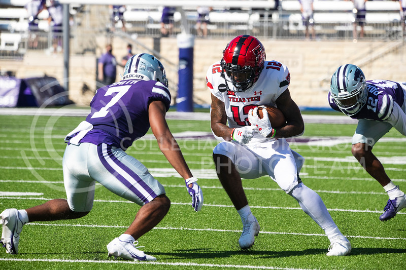 Senior defensive back Aj Parker and freshmen Tj Smith close in on a Texas Tech player. The Wildcats beat the Red Raiders 31-21 on Fort Riley Day at Bill Snyder Family Stadium. (Dalton Wainscott | Collegian Media Group).