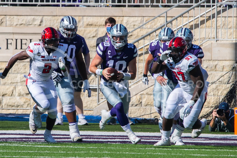 Senior quarterback Skylar Thomson runs through a gap between Texas Tech defenders. The Wildcats beat the Raiders 31-21 at Fort Riley Day at Bill Snyder Family Stadium. (Dalton Wainscott | Collegian Media Group).