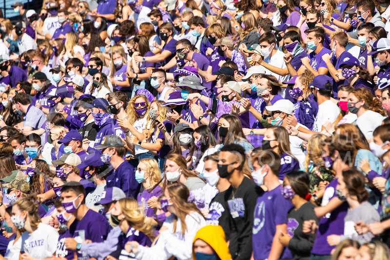 The K-State student section, adorned with masks, clap along to the Pride of Wildcat Land band. The Wildcats beat the Red Raiders 31-21 at Bill Snyder Family Stadium. (Dalton Wainscott | Collegian Media Group).