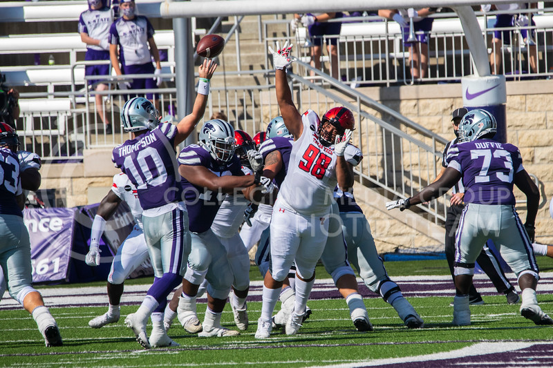 Senior quarterback Skylar Thompson throws the football into the end zone as a lineman attempts to block the pass. The Wildcats beat the Red Raiders 31-21 at Bill Snyder Family Stadium. (Dalton Wainscott | Collegian Media Group).