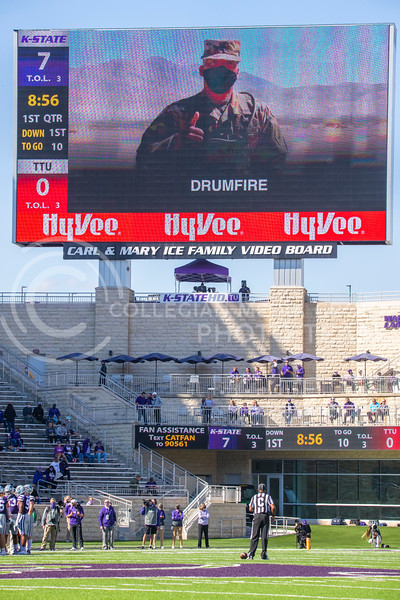A soldier wishes the Wildcats good luck over the big screen during a timeout in the first quarter. The Wildcats beat the Red Raiders 31-21 at Bill Snyder Family Stadium. (Dalton Wainscott | Collegian Media Group).