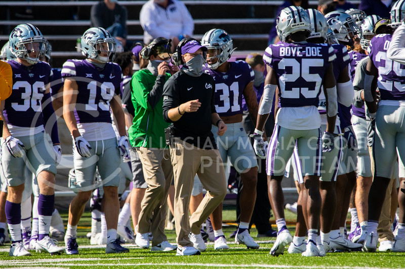 Head coach Chris Klieman talks with players in a huddle during a timeout. The Wildcats beat the Red Raiders 31-21 on Fort Riley Day at Bill Snyder Family Stadium. (Dalton Wainscott | Collegian Media Group).