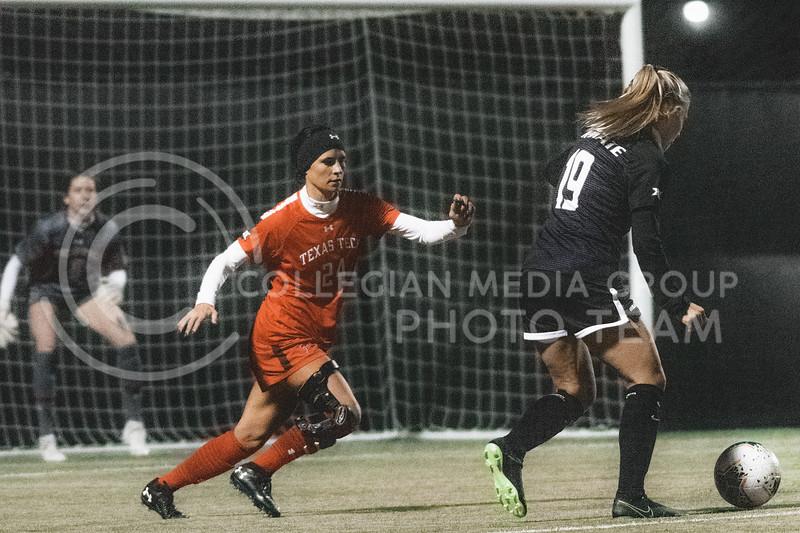 K-State Wildcat's senior midfielder, Christina Baxter, scores the first goal against Texas Tech defender, Margaret Begley. KSU finished the night 2-0 against TTU on senior night at Buser Family Park, Friday, November 13, 2020. (Dylan Connell   Collegian Media Group)