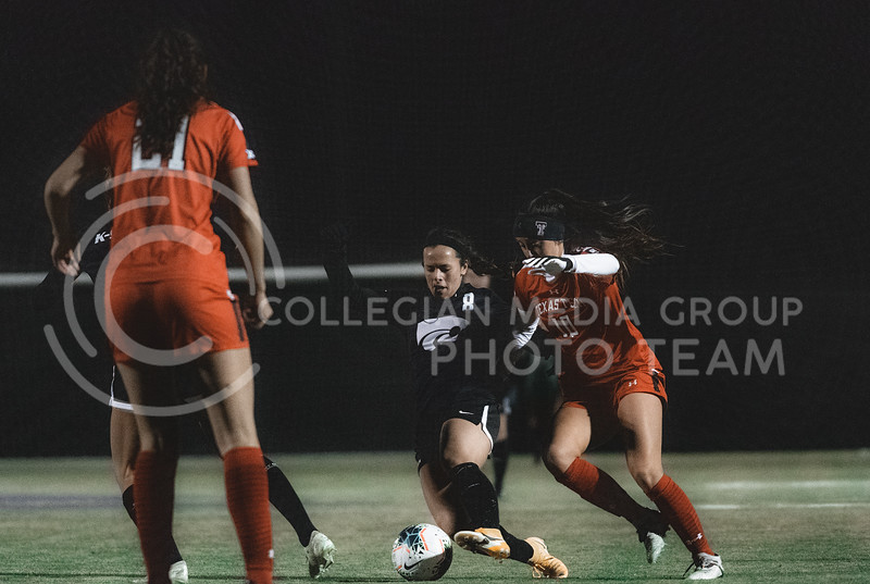 K-State Wildcat's senior midfielder, Brookelynn Entz, defends the ball while facing Texas Tech. KSU finished the night 2-0 against TTU on senior night at Buser Family Park, Friday, November 13, 2020. (Dylan Connell   Collegian Media Group)