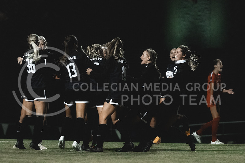 K-State Wildcat's senior midfielder, Christina Baxter, celebrates with teammates after scoring the first goal against Texas Tech. KSU finished the night 2-0 against TTU on senior night at Buser Family Park, Friday, November 13, 2020. (Dylan Connell   Collegian Media Group)