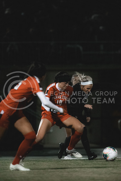 K-State Wildcat's senior midfielder, Maddie Souder, challenges a Texas Tech possession. KSU finished the night 2-0 against TTU on senior night at Buser Family Park, Friday, November 13, 2020. (Dylan Connell   Collegian Media Group)