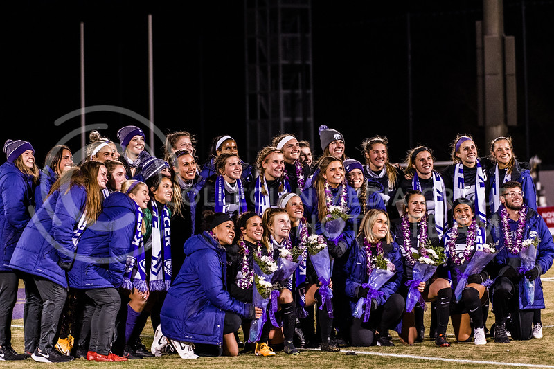 K-State Wildcats huddle together for photos after facing Texas Tech. KSU finished the night 2-0 against TTU on senior night at Buser Family Park, Friday, November 13, 2020. (Dylan Connell   Collegian Media Group)
