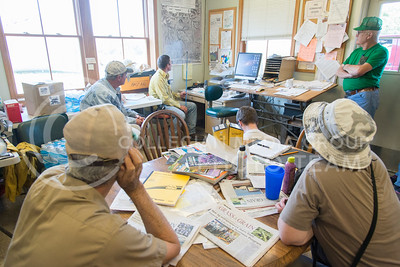The crew of volunteers helping on a burn for the Konza Prairie Biological Station meet at an office on the property to listen to instructions for the evening burn of watershed 'SuA' and 'SuB' on July 26, 2016. (Evert Nelson | The Collegian)