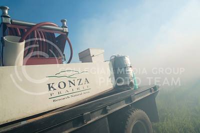 A water truck rushes by smoke that builds on a plot of land, called a 'watershed,' on July 26, 2016 as the Konza Prairie Biological Station performs an evening burn. (Evert Nelson | The Collegian)
