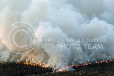 Smoke billows from fire on a watershed portion of the Konza Prairie on July 26, 2016. The Konza Prairie Biological Station peformed an evening burn for research related to grazing patterns and summer months for burning. (Evert Nelson | The Collegian)