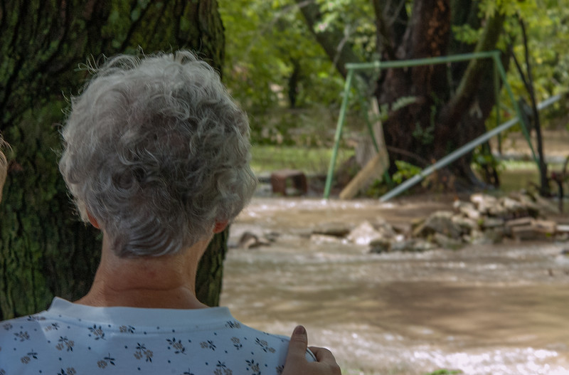 Looking at the swing that her son had built her, Linda is comforted by one of her daughters. The home that was directly in front of Wildcat Creek experienced some of the worse flooding in the area. (Rowan Jones | Collegian Media Group)