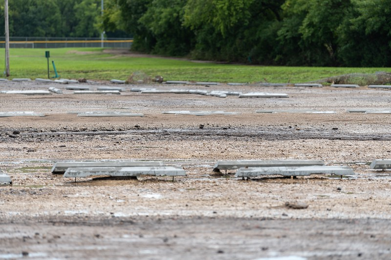 The Wildcat Creek parking lot gravel and asphalt have been eroded away, leaving holes as deep as two feet. (Alex Todd | Collegian Media Group)