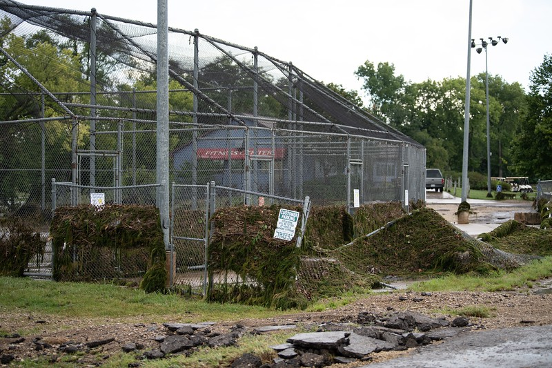 The fencing of the Wildcat Creek batting cages has been strewn with moss from the nearby lake. (Alex Todd | Collegian Media Group)