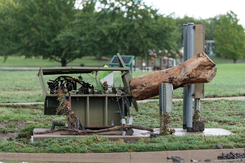 An electrical box was left completely destroyed by a large tree trunk near Wildcat Creek. (Alex Todd | Collegian Media Group)