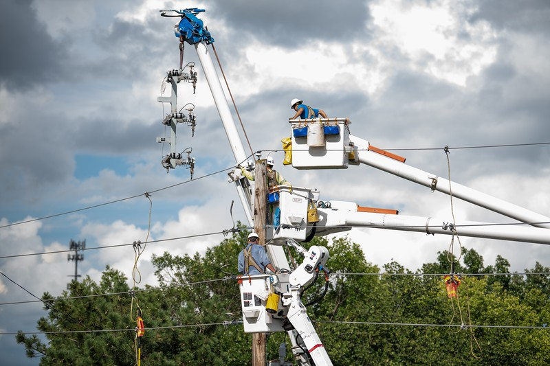Crews work to restore power near Anderson Ave. and Seth Child Road. (Alex Todd | Collegian Media Group)