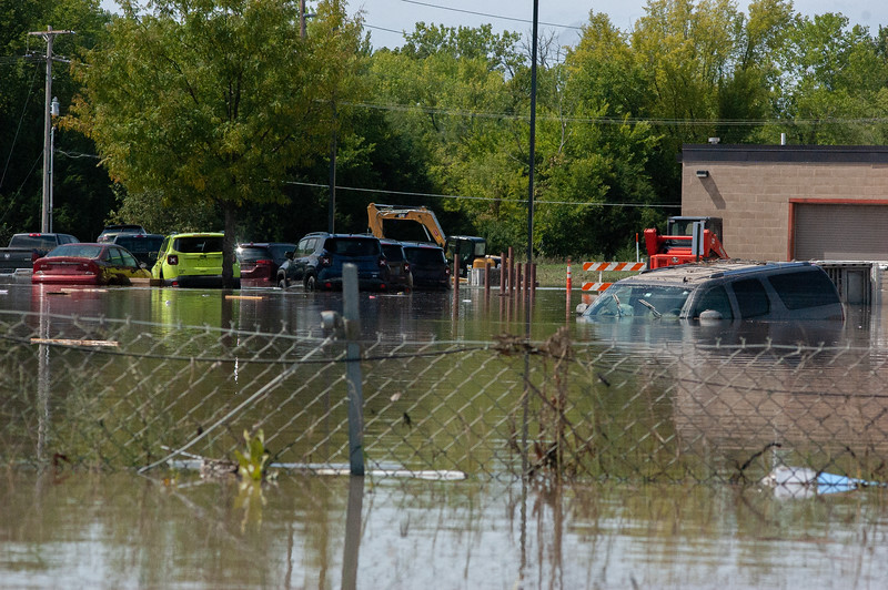 An SUV sits submerged in a stip mall's parking lot off of Anderson St. following the Labor Day floods.  (Rowan Jones | Collegian Media Group)
