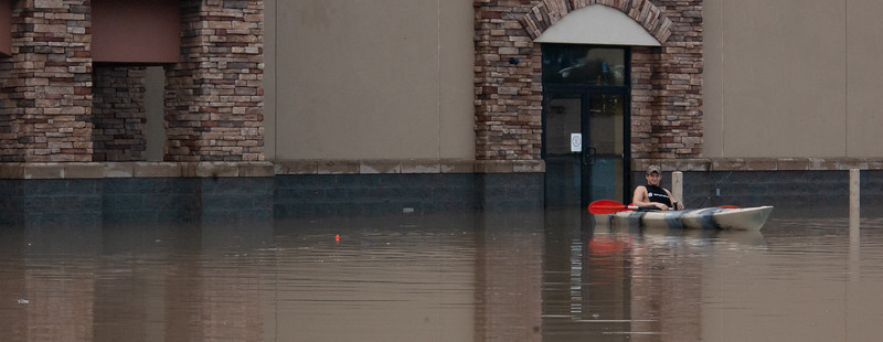 Fishing in his Kayak, Zach Holt sits in the parking lot of 3003 Anderson, follwing the Labor Day floods. (Rowan Jones | Collegian Media Group)