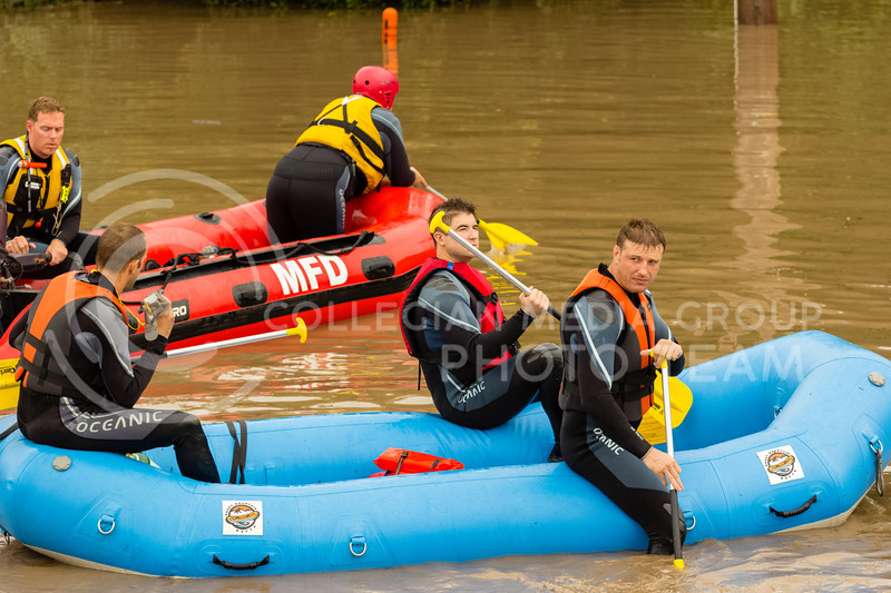 Manhattan Fire Department, Riley County Police Department and Pottawatomie County Sheriff's department work together to help recover Manhattan Ks residents traped by flood waters on Monday Sept 3rd 2018 (Alex Shaw | Collegian Media Group)