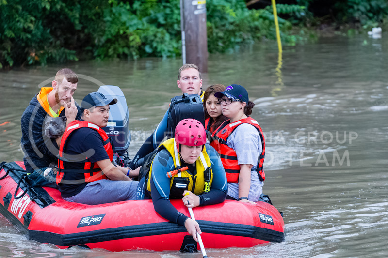 Manhattan Fire Department, Riley County Police Department and Pottawatomie County Sheriff's department work together to help recover Manhattan Ks residents trapped by flood waters on Monday Sept 3rd 2018 (Alex Shaw | Collegian Media Group)