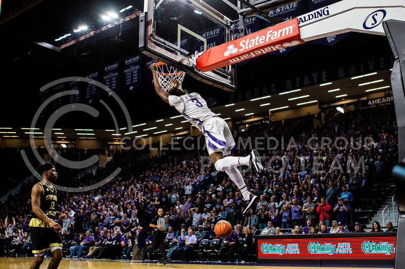 Freshman guard DaJuan Gordon leaps up for a dunk during K-State's basketball team's home opener against ESU in Bramlage Coliseum on Oct. 25, 2019. The Wildcats held the Hornets 86-49. (Michaela Wassall | Collegian Media Group)