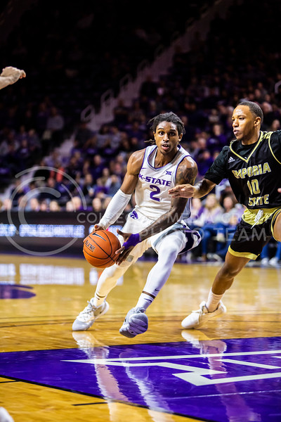 Junior guard Cartier Diarra charges the basket during K-State's basketball team's home opener against ESU in Bramlage Coliseum on Oct. 25, 2019. The Wildcats held the Hornets 86-49. (Logan Wassall | Collegian Media Group)
