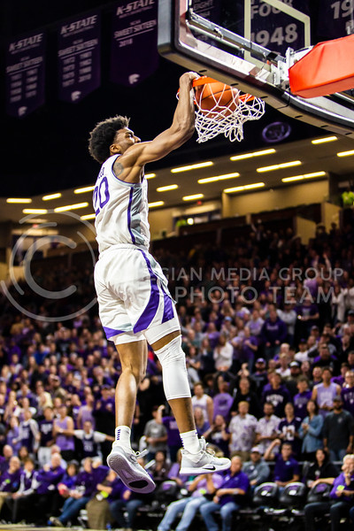 Senior forward Xavier Sneed leaps up for a dunk during K-State's basketball team's home opener against ESU in Bramlage Coliseum on Oct. 25, 2019. The Wildcats held the Hornets 86-49. (Logan Wassall | Collegian Media Group)