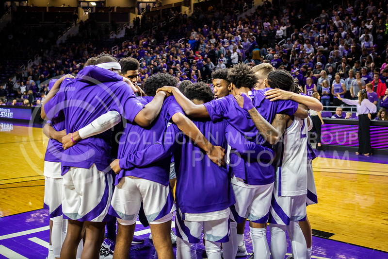 K-State's basketball team huddles together before their game against ESU in Bramlage Coliseum on Oct. 25, 2019. The Wildcats held the Hornets 86-49. (Logan Wassall | Collegian Media Group)