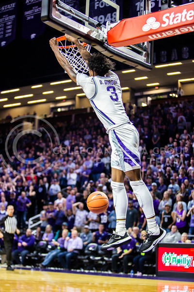 Freshman guard DaJuan Gordon leaps up for a dunk during K-State's basketball team's home opener against ESU in Bramlage Coliseum on Oct. 25, 2019. The Wildcats held the Hornets 86-49. (Logan Wassall | Collegian Media Group)