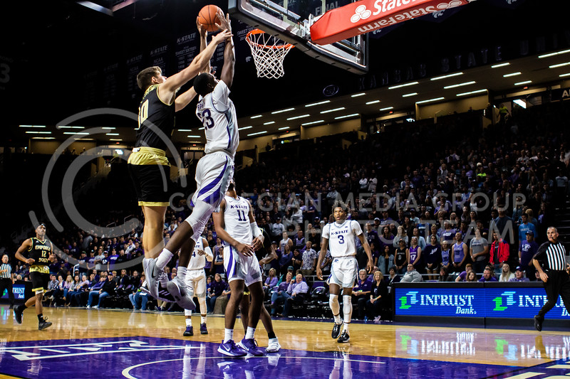 Freshman forward Montavious Murhpy leaps up for a shot during K-State's basketball team's home opener against ESU in Bramlage Coliseum on Oct. 25, 2019. The Wildcats held the Hornets 86-49. (Michaela Wassall | Collegian Media Group)