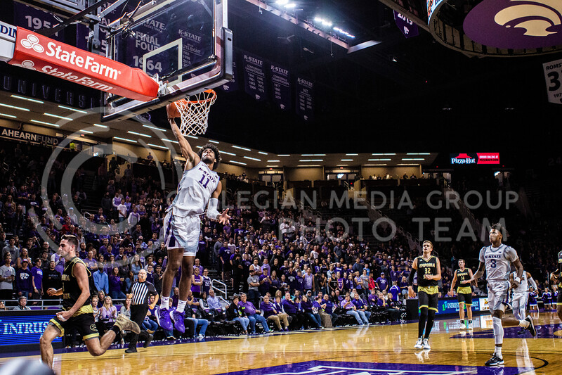 Freshman forward Antonio Gordon leaps up for a dunk during K-State's basketball team's home opener against ESU in Bramlage Coliseum on Oct. 25, 2019. The Wildcats held the Hornets 86-49. (Michaela Wassall | Collegian Media Group)