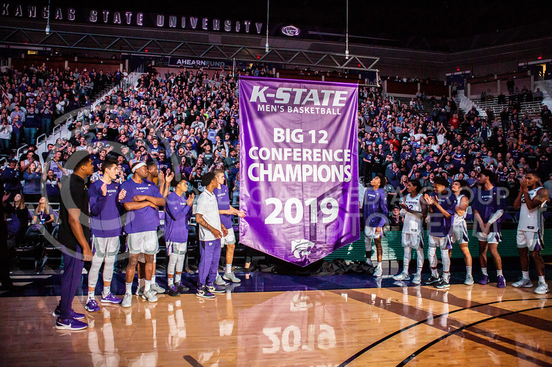 The 2019 Big XII championship banner is unveiled before K-State's basketball team's home opener against ESU in Bramlage Coliseum on Oct. 25, 2019. The Wildcats held the Hornets 86-49. (Logan Wassall | Collegian Media Group)
