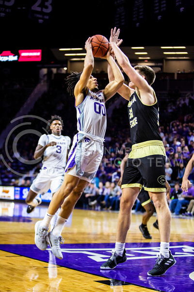 Junior guard Mike McGuirl charges the basket during K-State's basketball team's home opener against ESU in Bramlage Coliseum on Oct. 25, 2019. The Wildcats held the Hornets 86-49. (Logan Wassall | Collegian Media Group)