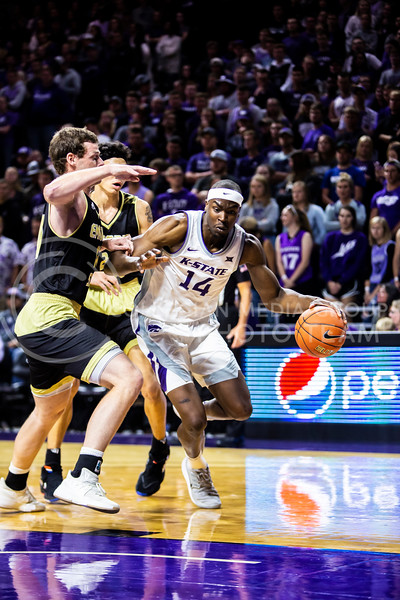 Senior forward Makol Mawein charges the basket during K-State's basketball team's home opener against ESU in Bramlage Coliseum on Oct. 25, 2019. The Wildcats held the Hornets 86-49. (Logan Wassall | Collegian Media Group)