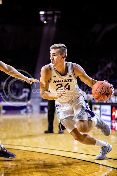 Senior forward Pierson McAtee charges the basket during K-State's basketball team's home opener against ESU in Bramlage Coliseum on Oct. 25, 2019. The Wildcats held the Hornets 86-49. (Logan Wassall | Collegian Media Group)