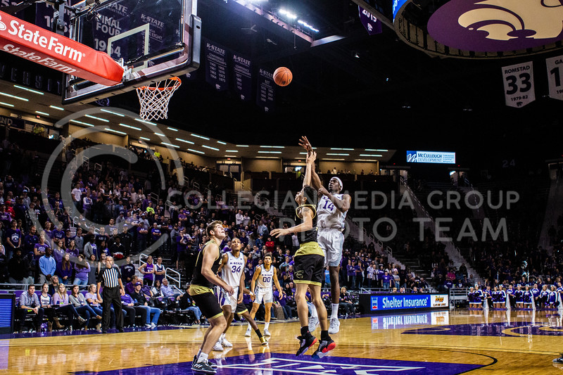 Senior forward Makol Mawein leaps up for a dunk during K-State's basketball team's home opener against ESU in Bramlage Coliseum on Oct. 25, 2019. The Wildcats held the Hornets 86-49. (Michaela Wassall | Collegian Media Group)
