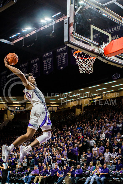 Senior forward Xavier Sneed leaps up for a dunk during K-State's basketball team's home opener against ESU in Bramlage Coliseum on Oct. 25, 2019. The Wildcats held the Hornets 86-49. (Michaela Wassall | Collegian Media Group)