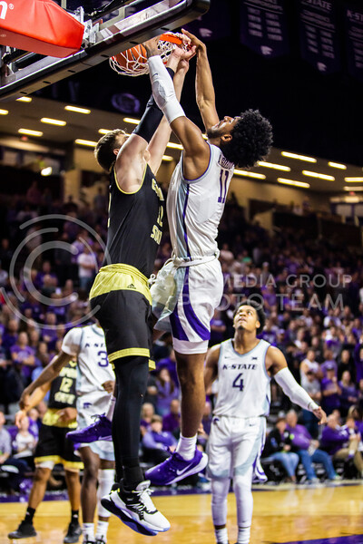 Freshman forward Antonio Gordon leaps up for a dunk during K-State's basketball team's home opener against ESU in Bramlage Coliseum on Oct. 25, 2019. The Wildcats held the Hornets 86-49. (Logan Wassall | Collegian Media Group)
